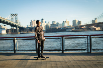 Young skateboarder cruise down on pedestrian walk