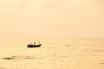Small lonely fishing boat floating on flat surface of adriatic s