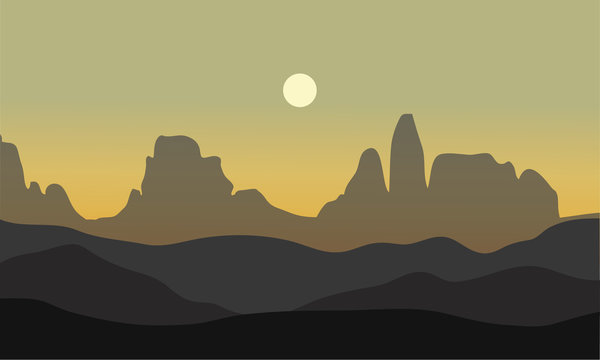 silhouette of desert with moon