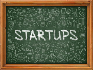 Startups - Hand Drawn on Green Chalkboard with Doodle Icons Around. Modern Illustration with Doodle Design Style.