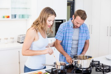 Young couple preparing a meal in kitchen