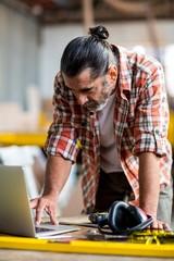 Carpenter using laptop