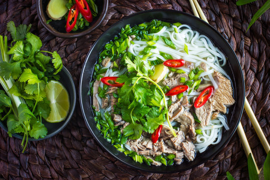 Traditional Vietnamese  soup Pho with beef and rice noodle