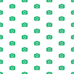 Seamless photography pattern with green cameras. Photo background template with dslr camera icons.