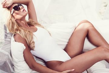 Beautiful woman lying in a cabana. sunbath
