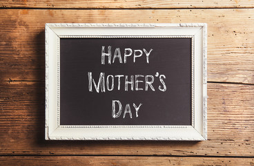 Mothers day composition. Picture frame. Wooden background. Studi