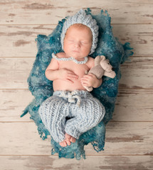 beautiful newborn baby sleeping on woolen blanket
