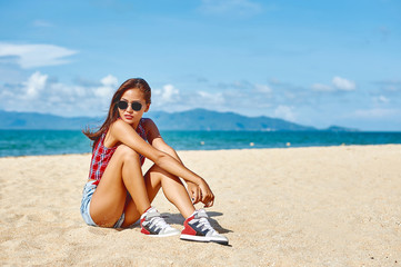 Portrait of young beautiful girl at the beach