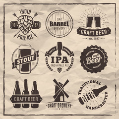 Set of vector craft beer logos and badges. Retro beer labels on vintage paper background