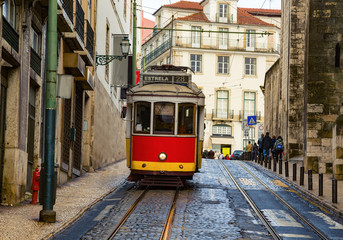 Romantic Lisbon street with the typical tram and Lisbon
