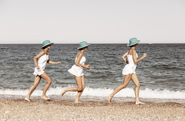Woman running on the beach. Multiple exposure shot.