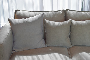 Close up image of gray color pillows with shade of shadow
