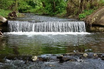 River flows through the cascade in nature