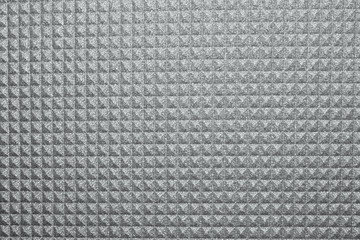 Gray yoga mat texture background.