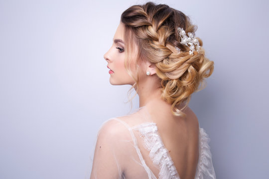 beautiful woman  bride with tiara on head  on bright background , copy space.
