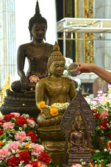 Thai Buddhist will do Watering The Buddha in Songkran Festival to show their respect.