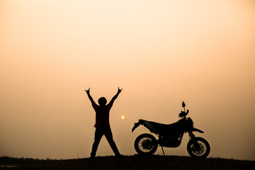 motorbike and biker with sunset background
