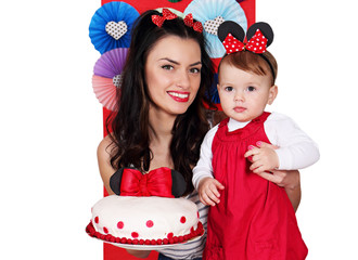 mother and daughter with cake