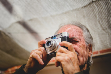 Elderly man with a camera