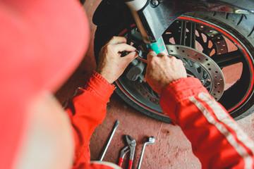 Senior man mechanic working in his workshop