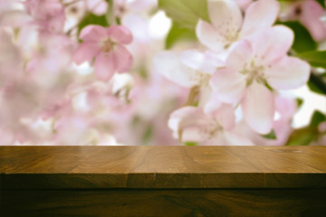 Empty top wooden table and floral blurred background