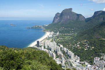 Scenic skyline view from above Sao Conrado Beach with Pedra da Gavea mountain and the favela community of Rocinha