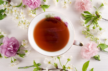 Tea with cherry blossom flowers, macaroons. Spring concept