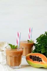 Homemade papaya, banana and mint smoothies