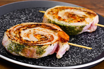 Roll of Bacon with Mushrooms, Carrots, Greens, Barbecue Grill