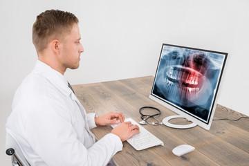 Doctor Looking At Teeth X-ray