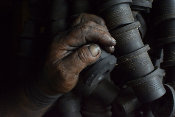 Hand of working man covered with oil