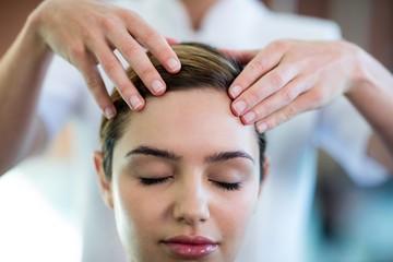 Woman receiving a head massage Wall mural