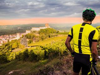 Cyclist admires the Soave castle views.