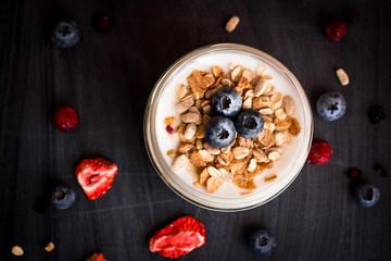 Healthy breakfast - yogurt with blueberries and muesli served in bank