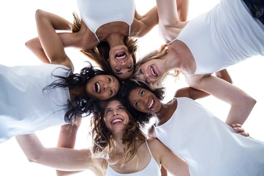 Happy women forming a huddle