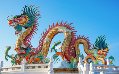 Colorful dragon statue with blue sky at Nakornsawan Park, Thailand
