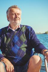 elderly man on yacht at sea