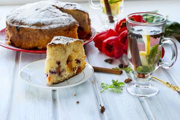 home-made cake with fruit and fragrant tea with lemon, cinnamon