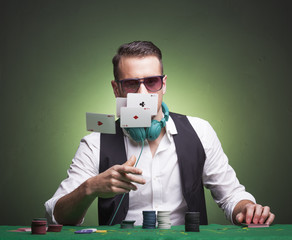 Poker player throwing cards at the table