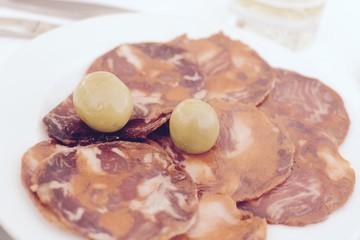 Spanish style tapas, chorizo and olives