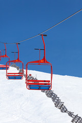four red chairs of ski lift
