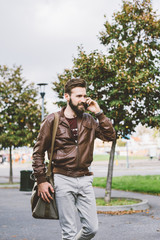 Knee figure of young handsome caucasian brown hair bearded man w
