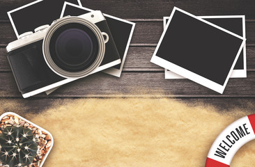 vintage  design, camera and blank photo frames on black wooden table. top view