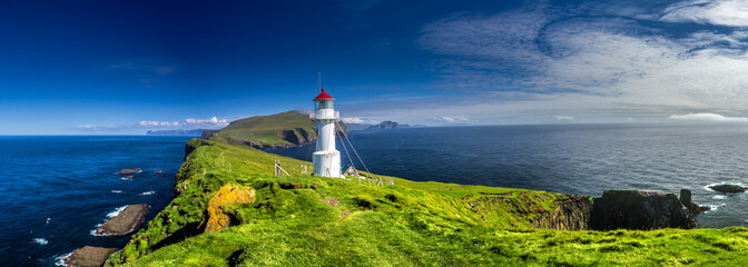 Fotobehang Vuurtoren Panoramic view of Old lighthouse on the beautiful island Mykines.