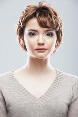 Young woman close up face beauty portrait.Short Hair style. Fem