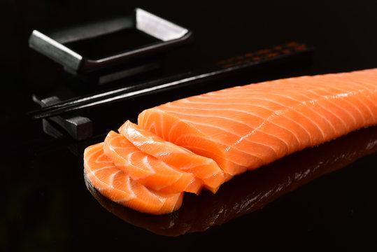 Fresh salmon fillet on black blackground