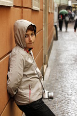 child with camera in the rain , the concept of simplicityl