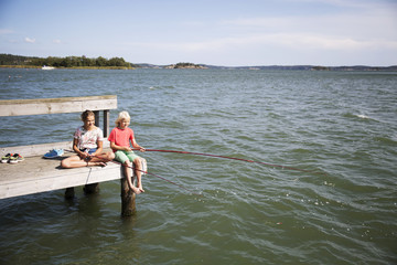 Boy and girl fishing