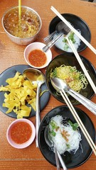 Vermicelli,sui yellow and rice noodle in black bowl. and fried dumplings in black plate eat with Tom Yum Goong,,delicious and famous in Thailand