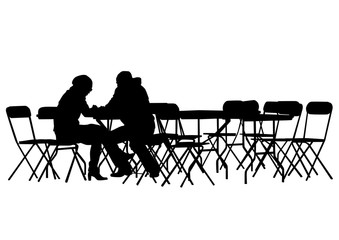 Silhouettes of people in urban cafe